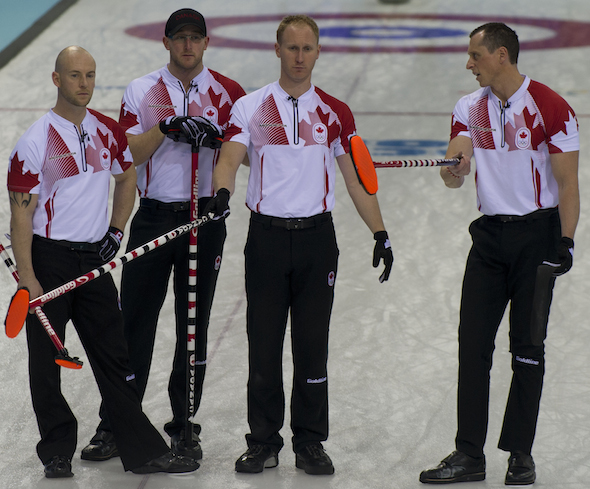 Team Canada discusses the options in the 10th end against the U.S. on Sunday in Sochi. (Photos, CCA/Michael Burns)