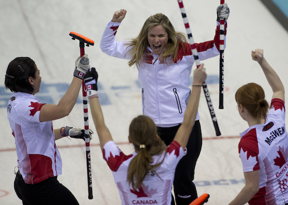 From left, Jill Officer, Kaitlyn Lawes, Jennifer Jones and Dawn McEwen celebrate their win on Wednesday. (Photos, CCA/Michael Burns)