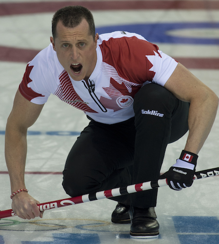 Team Canada second E.J. Harnden calls instructions to sweepers on Sunday.