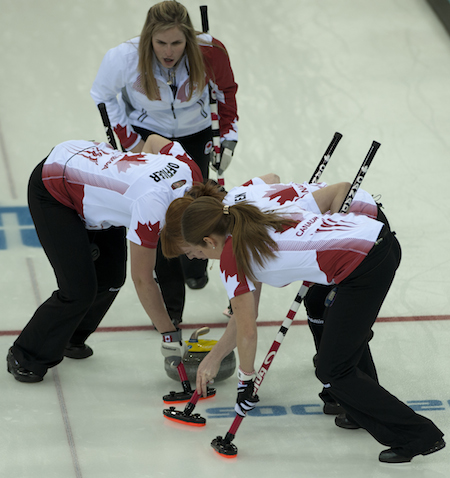 The whole team gets involved on a shot during Thursday's gold-medal game.