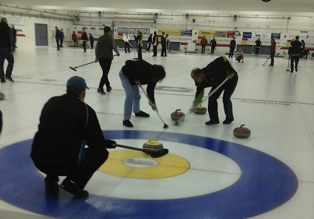 Action on the ice at the McArthur Island Curling Club in Kamloops (Photo K. Arnold)