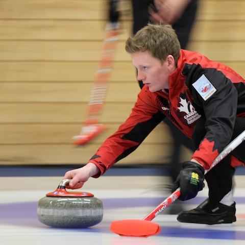 Braden Calvert in action at the 2014 World Junior Curling Championship in Flims, Switzerland (Photo WCF/Richard Gray)