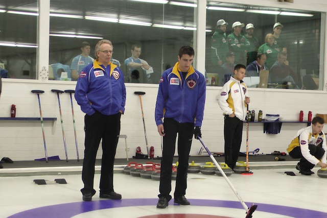 Coach (and dad) Jim Lautner gives some advice to Alberta skip (and son) Carter during practice at the 2014 M&M Meat Shops Canadian Junior Curling Championships in Liverpool, N.S.  (Photo courtesy C. Lautner)