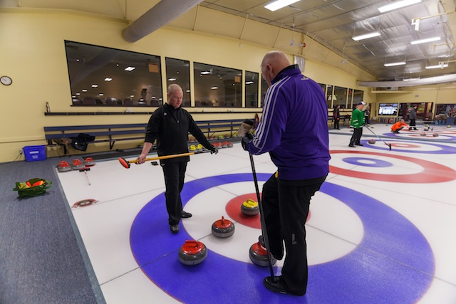 Gary Crossley, director of the Hawks High Performance Curling Centre, works with curler Graham Rae on the ice at KW Granite Club in Waterloo (Photo V. Tremaine)