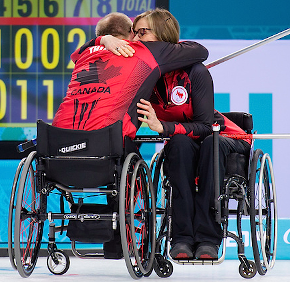 Team Canada's Dennis Thiessen, left, and Sonja Gaudet embrace at the Ice Cube Curling Centre. (Photo: Matthew Murnaghan/Canadian Paralympic Committee)