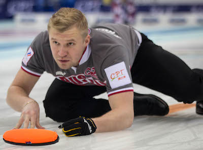 Russian vice-skip Alexey Stukalskiy watches his shot. (Photo, World Curling Federation/Richard Gray)