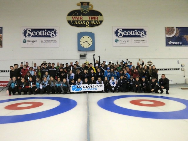 Eighteen Bantam teams with their coaches and instructors pose on the ice at the Town of Mount Royal Curling Club during the recent Canada Winter Games skills camp offered by Curling Quebec (Photo courtesy Curling Quebec)