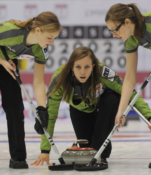 Lynn (left) and Alison (right) sweep for skip Rachel Homan at the 2009 Road to the Roar Olympic pre-trials in Prince George, B.C. (Photo Michael Burns)