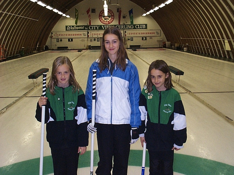 Three young Kreviazuk sisters (Lynn, Alison and Cheryl) pose on the ice at the City View Curling Club in Ottawa, where it all began (Photo courtesy D. Kreviazuk)