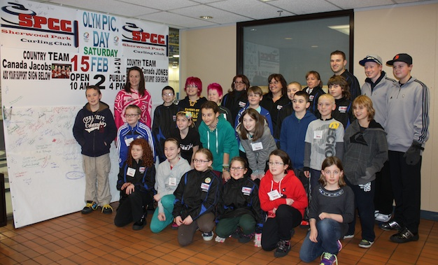 Heather Nedohin joined Junior program convenors Lynn Penner and Christy Fehr (back row, in black jackets) with junior curlers for an Olympic Day event in February (Photo Dan Girard)