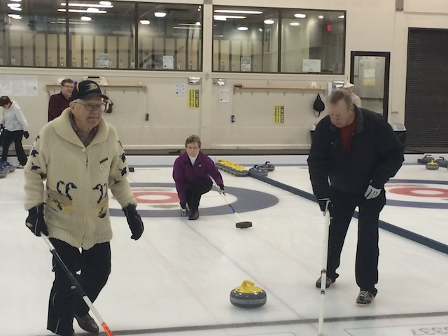 At age 88, Jack Lukey (white sweater) is the club's second oldest curler. Lukey, who still throws from the hack, curls in two Senior leagues (Photo Dan Girard)