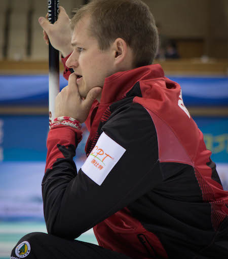 Team Canada second Carter Rycroft checks out his shot. (Photo, World Curling Federation / Céline Stucki)
