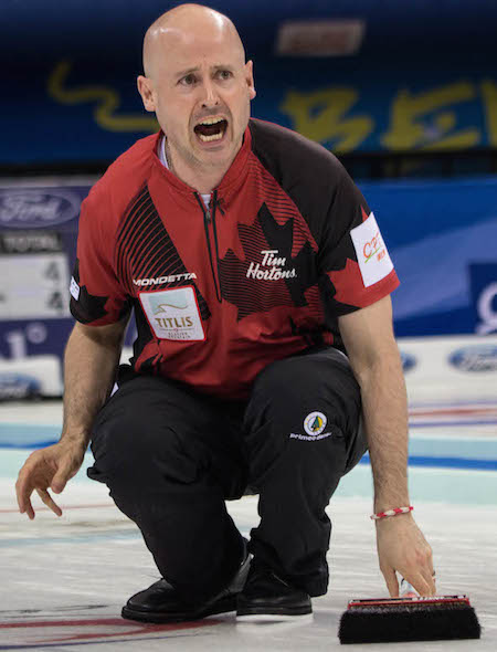 Canadian skip Kevin Koe shouts instructions to sweepers. (Photo, World Curling Federation / Céline Stucki)
