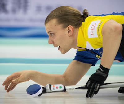 Sweden's Markus Eriksson watches his shot on Wednesday. (Photo, World Curling Federation / Céline Stucki)