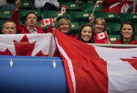 Fans from Donnelly, Alta., cheer on Team Canada on Wednesday in Beijing. (Photo, World Curling Federation / Céline Stucki)
