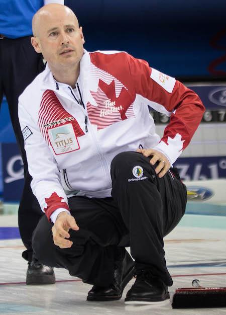Canadian skip Kevin Koe watches his shot. (Photo, World Curling Federation / Céline Stucki)