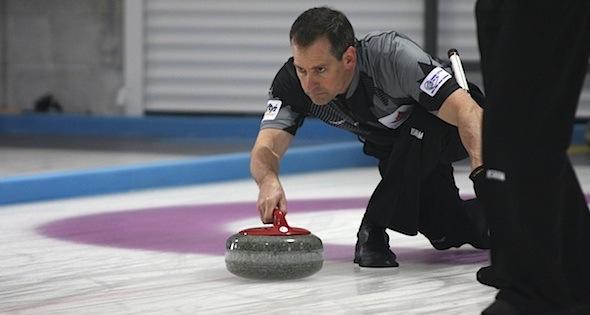 Canadian skip Wayne Tallon in action at the 2014 World Senior Curling Championships in Dumfries, Scotland (Photo WCF/Hugh Stewart)