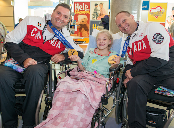 Mark Ideson and Dennis Thiessen visiting children during the Celebration of Excellence Heroes Tour visit to the Alberta Children's Hospital in Calgary. (Photo, Matthew Murnaghan/Canadian Paralympic Committee)