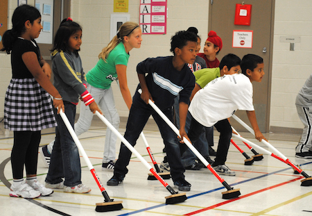 Kids get exposed to curling in a fun setting in schools across Canada.