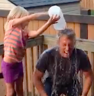 Marc Kennedy gets wet, courtesy of his daughter.